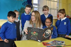 Hayley Cheeseman, headteacher at The Grove Primary School, chats to pupils during a reading session EMN-191126-130909001