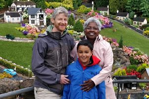 Jothi Brown (10), who survived a potentially deadly bout of meningitis, with mum Bharathi and dad Jeff EMN-191230-170018001