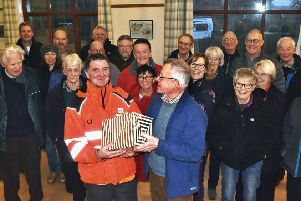 Grimston villagers turn out to say goodbye to their long-serving postman, Graham, with resident Tony Moore presenting him with the �344  collected by locals EMN-200601-152238001