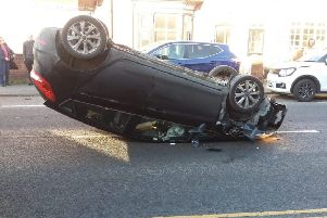 A car oin its roof on Thorpe Road, Melton, following a collision on Friday'PHOTO KATE BISHOP EMN-200113-130729001