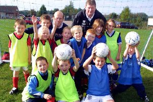Ian (back, right) was a big champion of youth footballers EMN-200128-160850002