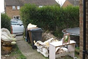 The garden waste at Greaves Avenue, Old Dalby, which led to householders appearing in court after being issued with Community Protection Notices by Melton Borough Council EMN-201202-161317001