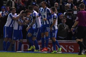 Together: Brighton & Hove Albion players celebrate. Picture by Phil Westlake