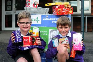 Nine-year-olds Olly Wright and Finley Hills are collecting for the Chichester District Foodbank. Picture: Kate Shemilt ks171482-1