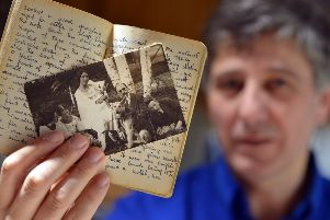Tim Locke with a photograph of his grandparents, Hans and Vera Neumeyer