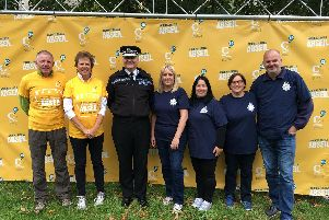 Derwyn Jones, Chestnut Tree House's chairman of trustees, Caroline Nicholls, High Sheriff of West Sussex, Giles York, chief constable of Sussex Police and members of the force