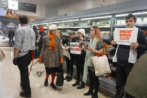 Vegan activists at the meat aisle in Waitrose, Brighton (Photographs: Direct Action Everywhere)