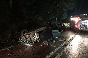 A car fliiped on its roof in a crash along the A272 near Wisborough Green. Photo by Billingshurst Fire Station