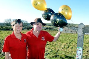 Keith McKenna and Sally Dench celebrating the 40th anniversary of the South Downs Way Annual Walk. Picture: Kate Shemilt ks190040-1