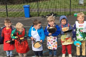 Midhurst Nursery Class children pose with their pancakes