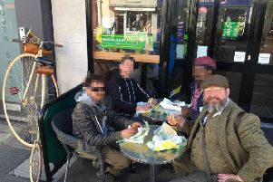 Steven Payne was bought lunch by the homeless people he has helped. In agreement with him we have modified the photo to protect the identities of those he is lunching with.