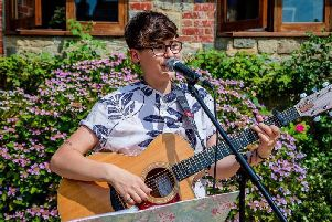Rylee Spooner is entertaining at the mental health awareness day at The Grange, Midhurst