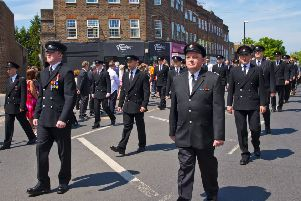 Mark's son, Adam leading the way at the funeral procession in Haywards Heath, proudly wearing his medals. Photo by Eddie Howland
