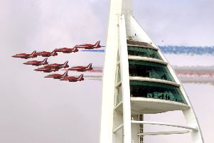 Flashback to the RAF Red Arrows flying past the Spinnaker Tower.  PICTURE: STEVE REID