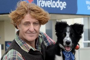 Tom Rowland with his puppy JB. Picture: Kate Shemilt