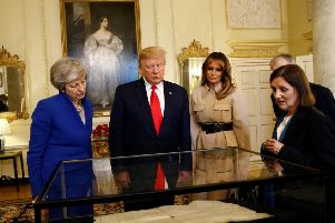 West Sussex County Archivist Wendy Walker delivered a presentation to President Donald Trump, Melania Trump, First Lady of the United States, Prime Minister Theresa May and her husband Philip May. Photo: HENRY NICHOLLS/AFP/Getty Images