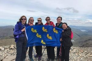 Martlet Mountaineers, friends Linda Evans, Christine Gillott, Linda Doughty, Sue Eden, Sharon Fisher and Debbie Fisher fly the Sussex flag at Scafell Pike