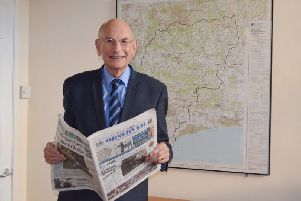 Cllr Tony Dignum stood in front of a map of Chichester district