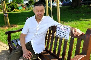 Tony Duffy on the park seat now unofficially designated a buddy bench