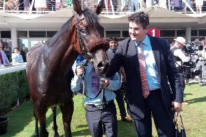 The 2018 Stewards' Cup winner Gifted Master with trainer Hugo Palmer