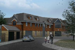 Artist's impression of a new Co-op and flats planned for Loxwood SUS-191207-160342001