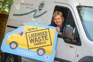 Councillor Penny Plant showing the symbol available to licensed wasted carriers.