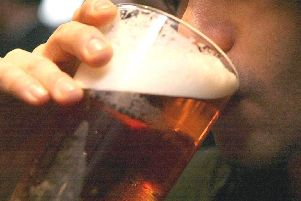 A man drinking a pint of beer.