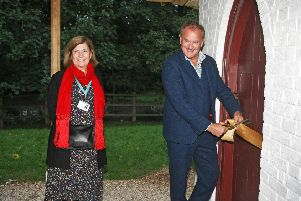 DM19100624a.jpg. The official opening of the Newdigate Bakehouse and Eastwick Park Dairy at the Weald and Downland Museum. Hugh Bonneville opens the dairy accompanied by Jo Pasricha, chairman of the trustees. Photo by Derek Martin Photography. SUS-190310-214905008