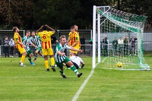 Lloyd Rowlatt scores the winner against Enfield to clinch City's place in the fourth qualifying round / Picture by Daniel Harker