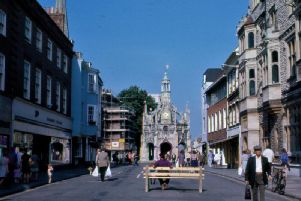 East Street in 1975 during the 'experimental phase of the pedestrianisation' Vehicles have been excluded but the carriageway and pavements remains. Alan Green said the bench was placed to 'reassure the nervous'. This was the major initiative to be adopted from the study, and was made permanent in 1976.