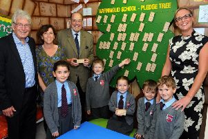Some of the children with chair of governors Bob Clark, headteacher Marion West, Sir Nicholas Soames MP and parent Helen Grove