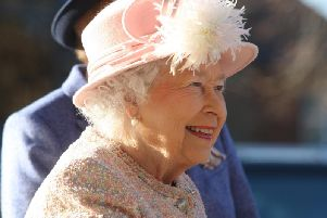 The Queen smiles as she visits the Chichester Festival Theatre