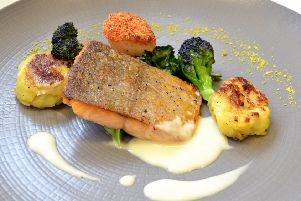 Pan-fried trout fillet and scallop with passion fruit fish velout� and rustic potatoes
