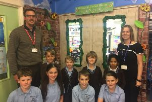 Blackthorns Primary School vice-principal Tom Jordan and principal Marianne Brand with some of the pupils