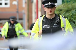 Police at the scene of the stabbing of Antony Williams last year. Pictures: Eddie Mitchell
