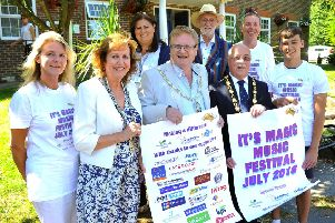 Front row: Samantha Norgate of Kangaroos Fun Disability Clubs, Burgess Hill mayor Chris Cherry, mayor of Haywards Heath Jim Knight, district council chairman Bruce Forbes, and Joshua Wells of Kangaroos. Back row: Anna Hull of Woodlands Meed, Tim French MBE founder and director of It's Magic Events, and Peter Ackland CE of Kangaroos. Picture: Steve Robards