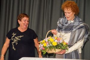 Judy Parfitt recieving flowers for opening the anniversary party SUS-180309-084836001