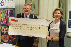 Mayor, Cllr James Knight presents Pilar Cloud with a cheque for funds raised at his Twinning Anniversary and Charity Gala Night SUS-180917-100240001