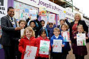 Children from St Joseph's Primary School being awarded prizes for their Christmas cards at The Orchards in Haywards Heath last year. Picture: Steve Robards