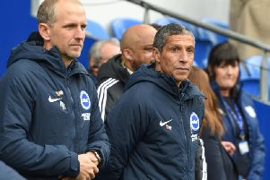 Brighton & Hove Albion manager Chris Hughton and assistant Paul Trollope watch on. Picture by PW Sporting Photography