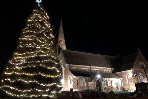 The Christmas tree is lit with new lights after a success fundraising appeal. Photo contributed
