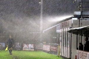 Rain hits Nyetimber Lane during a recent game versus Peacehaven - and there's been more of the same today / Picture by Roger Smith