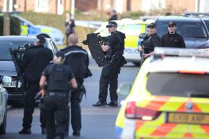 Armed police on scene, photo by Eddie Mitchell