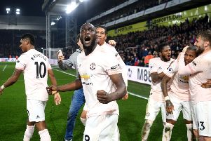 Romelu Lukaku of Manchester United celebrates after his team's third goal scored by Ashley Young of Manchester United (2R) during the Premier League match between Crystal Palace and Manchester United at Selhurst Park. (Photo by Mike Hewitt/Getty Images)