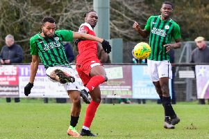Cheick Toure clears the ball for Burgess Hill Town in their 3-0 home defeat against Leatherhead in the Bostik Premier on Saturday. All pictures by Chris Neal.