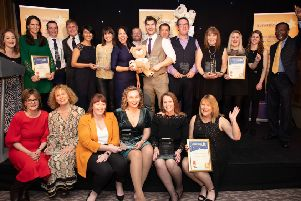Chestnut Tree House Business Awards 2019 winners on stage with hosts Allison Ferns and Ambrose Harcourt, Chestnut Tree House vice-president