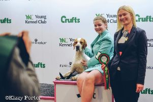 Lauren Goddard and dog Parker at Crufts. Picture by Kizzy Porter. SUS-190313-102057001