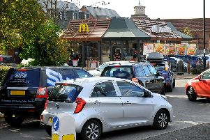 Traffic queueing to enter McDonald's drive thru Burgess Hill is causing problems on the roundabout just outside. Pic Steve Robards SR1829128 SUS-180311-162546001