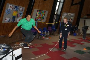 An LVS Hassocks student is coached at skipping by a Hurstpierpoint College sports leader