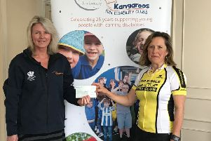 The cheque was presented by Angela Murray to Samantha Norwood